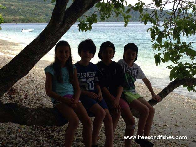 Kids hanging out under the tree