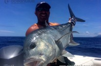 Angler holding huge GT Fish