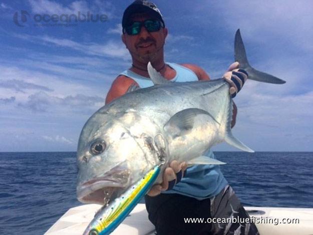 angler holding big GT Fish