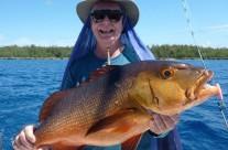happy to catch a big red bass fish in our Vanuatu trip