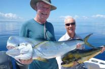 Happy catching a big mahi mahi and yellowfin tuna in Vanuatu