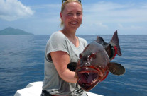 Helen shows her first catch after fishing in Vanuatu